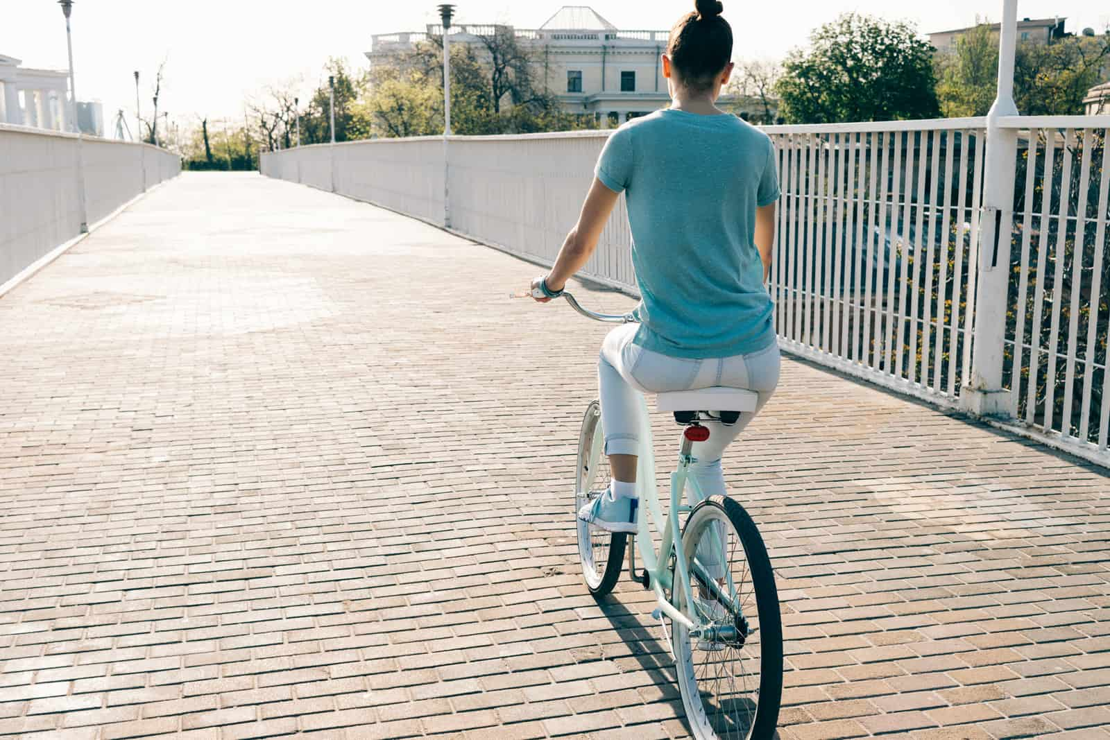 slim girl riding a step through bike