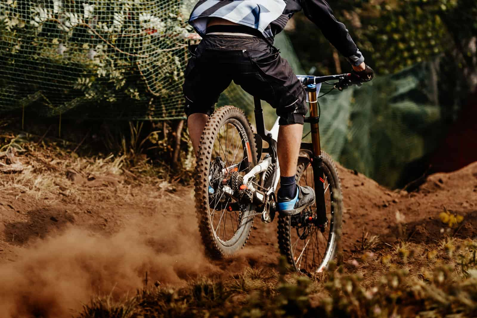man with mountain bikes under 1500