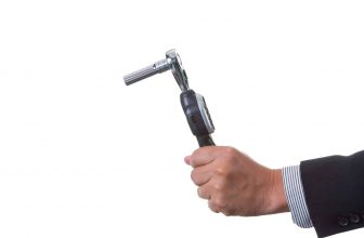 man holding torque wrench for bikes