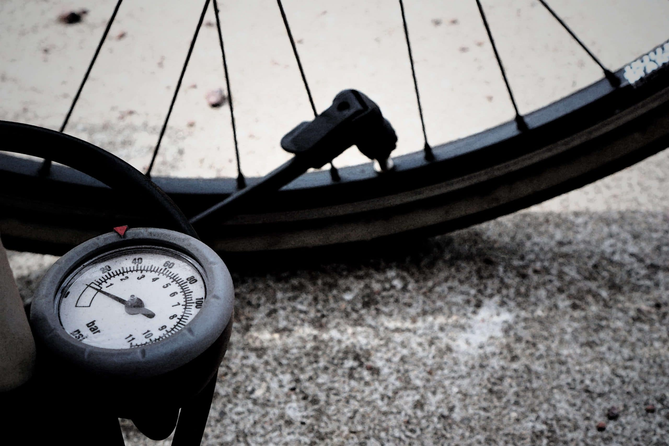 bicycle tire pressure gauge attached to bike tire