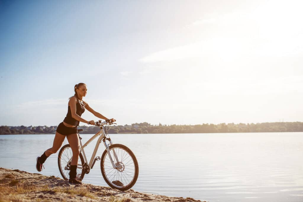 womens commuter bike on the beach