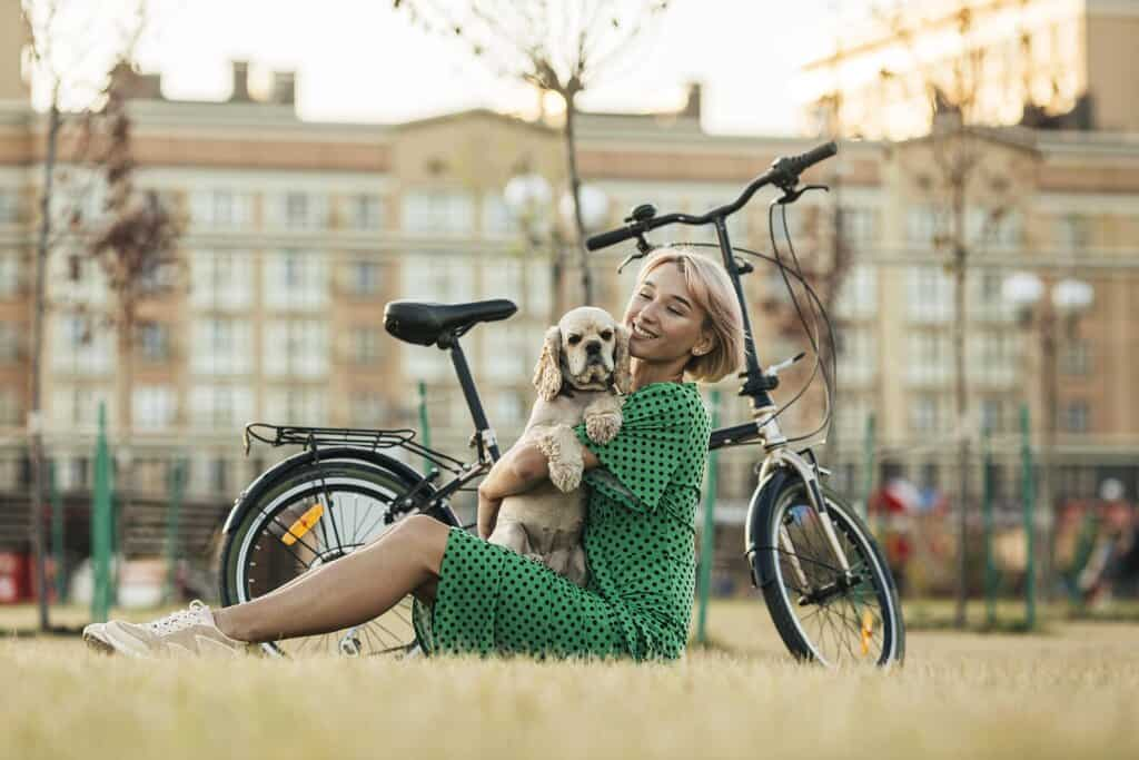 girl with her bike and with dog