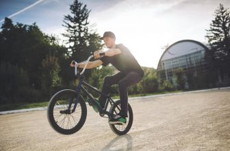 man doing tricks with lightweight bmx bikes